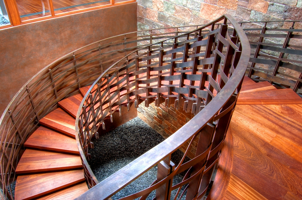 Sculptural Elliptical Steel Staircase with Patina Finish