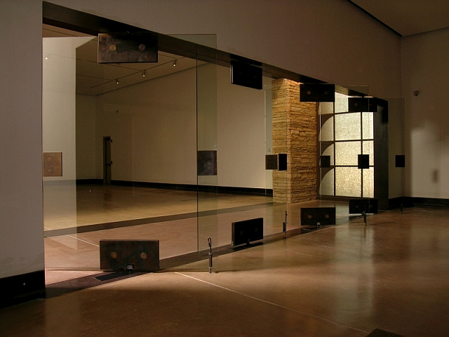 Patinated Center pivot hinged Steel & Glass Doors at the Haak'u Museum - Acoma Sky City Cultural Center, NM