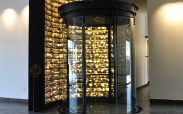 Rockwall: Radiused Steel Plate, Rocks & Polycarbonate with back lighting (Living Room Elevation shown)